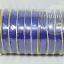 ริบบิ้นพับเหรียญ เนื้อมัน เบอร์ 2 ตราดอกไม้(มีฝา) (กว้าง 1.1 cm ยาว 40 หลา)*บางกว่าแบบไม่มีฝา thumbnail 3